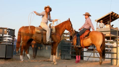 cowgirl on horseback doing lariat tricks - rodeo stock videos & royalty-free footage