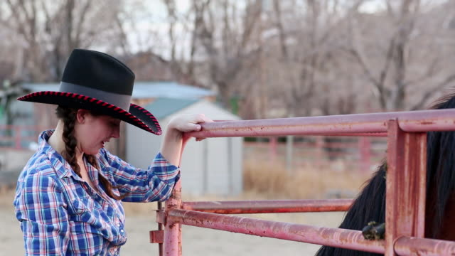 MS TU TD Cowgirl petting her horse / Santa Fe, New Mexico, United States