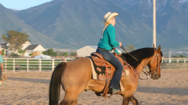 cowgirl riding in the ring at a rodeo - cowgirl stock videos & royalty-free footage