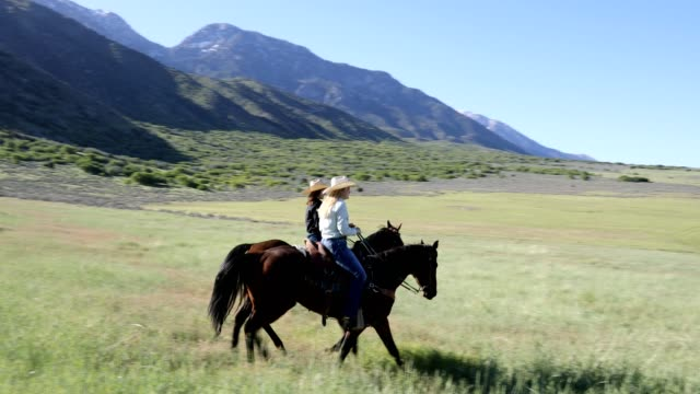 Cowgirls Horseback Ride in the Country