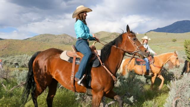 cowgirls riding horses on in the wilderness - utah stock videos & royalty-free footage