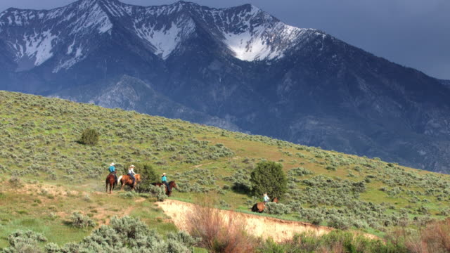Cowgirls Riding Through Beautiful Utah Landscape