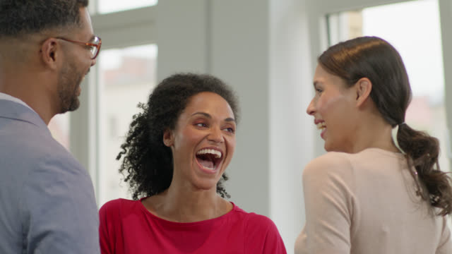 coworkers / colleagues having fun discussing business topics after work, - male with group of females stock videos & royalty-free footage
