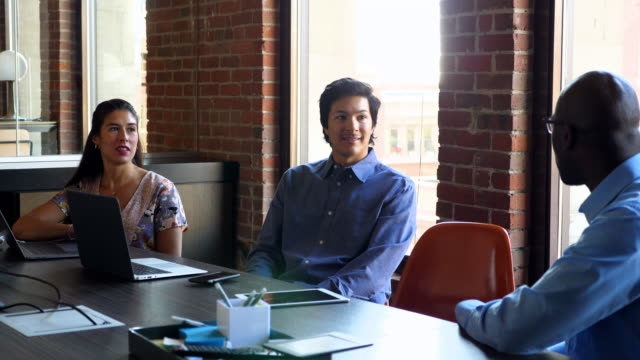 MS Coworkers discussing project during meeting in office conference room