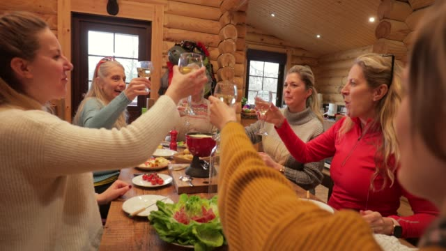 coworkers eating dinner in a log cabin - fondue stock videos & royalty-free footage