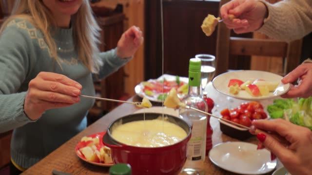 coworkers eating dinner - fondue stock videos & royalty-free footage