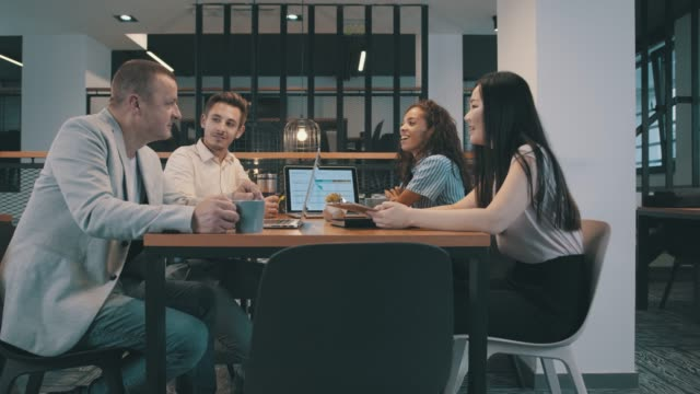 coworkers having a casual discussion during a business meeting - east asian ethnicity stock videos & royalty-free footage