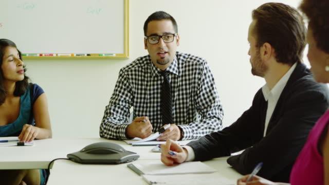 ms coworkers in discussion at conference room table - skjorta och slips bildbanksvideor och videomaterial från bakom kulisserna