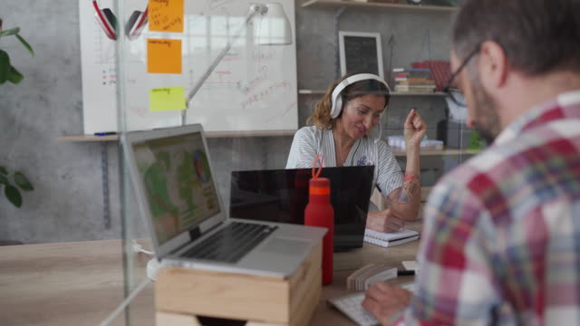 coworkers in office during covid-19 pandemic - protection stock videos & royalty-free footage