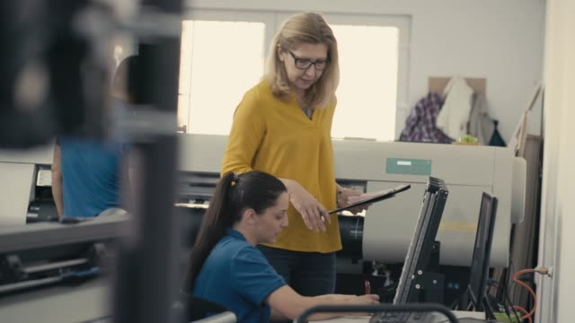 coworkers in printing factory - machine part stock videos & royalty-free footage
