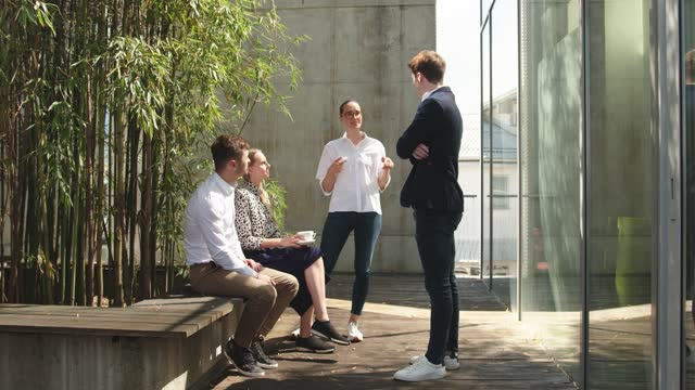 coworkers on a lunch break on the office terrace - conference table stock videos & royalty-free footage