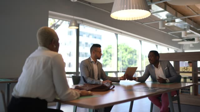 coworkers on a meeting at modern office - business relationship stock videos & royalty-free footage