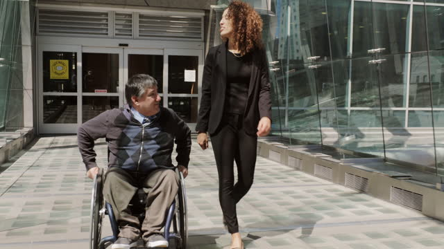 coworkers outside an office - persons with disabilities stock videos & royalty-free footage