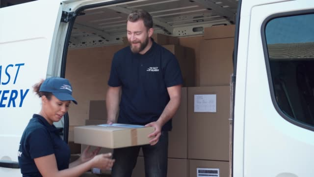 coworkers rushing to load packages in a delivery van - cart stock videos & royalty-free footage