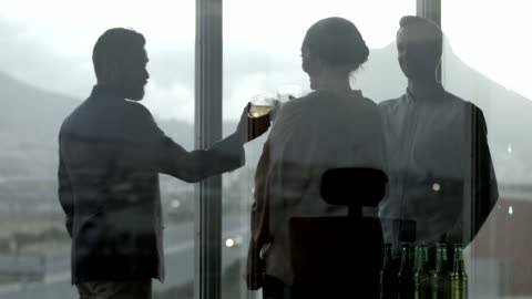 coworkers toasting drinks during office party - after work stock videos & royalty-free footage