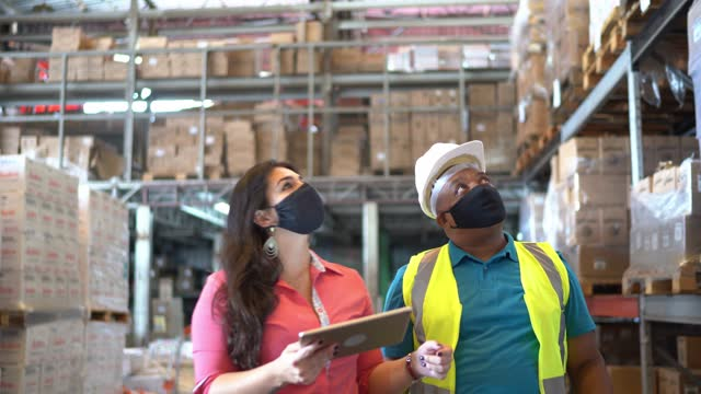 coworkers wearing face mask doing a meeting in a distribution warehouse - inspector stock videos & royalty-free footage