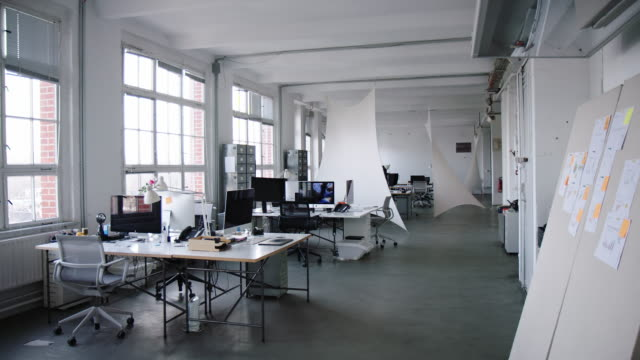 coworking desks at a creative office - no people stock videos & royalty-free footage