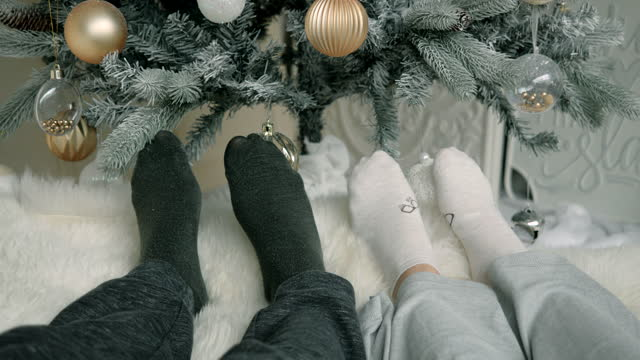 cozy christmas socks relaxing stay above christmas. - sock stock videos & royalty-free footage