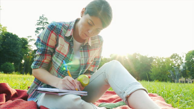 cozy female taking notes. - author stock videos & royalty-free footage