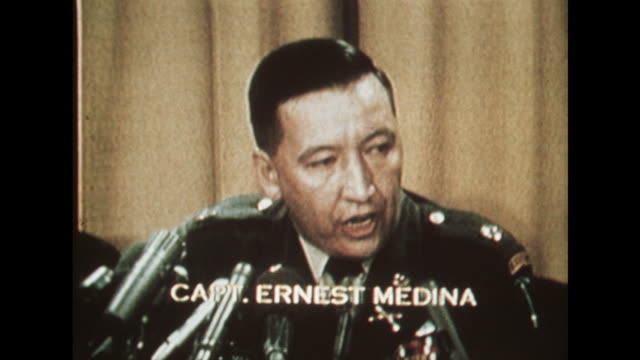 cpt ernest medina at a pentagon hearing denies shooting children and ordering the killing of civilians at my lai - 銃撃事件点の映像素材/bロール