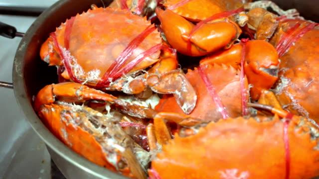 Crabs stream in pod, cooking in kitchen