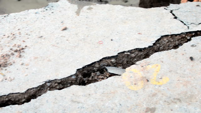 crack in the sidewalk - earthquake stock videos and b-roll footage