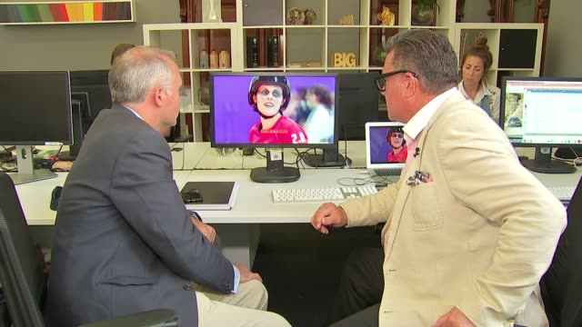 crackdown on adverts that encourage gender stereotypes int tim doust and reporter seated watching 'this girl can' campaign video - gender stereotypes stock videos & royalty-free footage