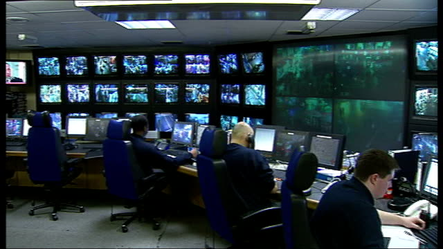 cctv control room england london int officers manning cctv control room operating controls that move cameras and viewing monitors - riksha bildbanksvideor och videomaterial från bakom kulisserna