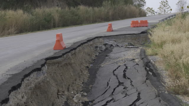 cracked and broken asphalt road from earthquake - damaged stock videos & royalty-free footage