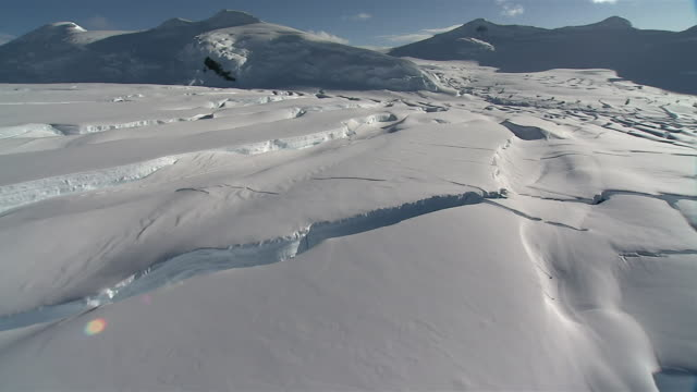 low aerial, cracked glacier, antarctica - antarctica stock videos & royalty-free footage