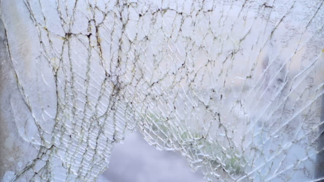 cracked of glass window - windshield stock videos & royalty-free footage