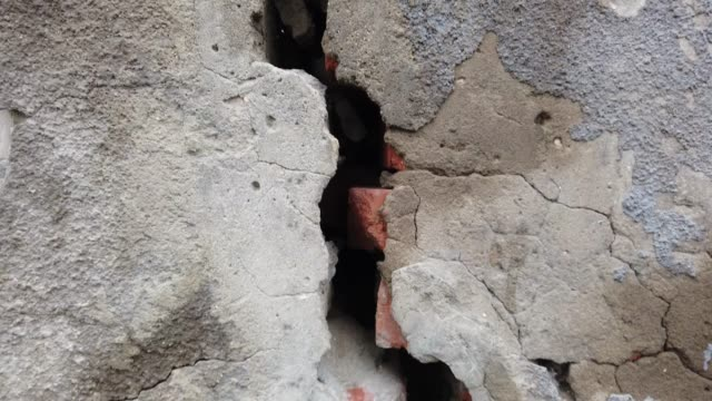 cracked wall, ruined house from outside - concrete stock videos & royalty-free footage