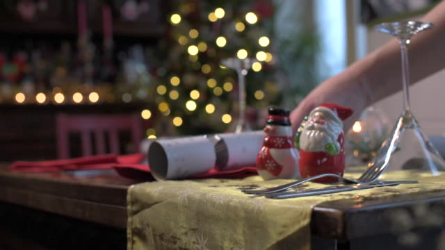 a crackers is laid to a christmas dinner table - cracker stock videos and b-roll footage