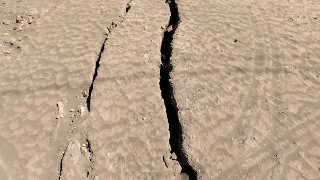 cracks damage road due to uplift from magma rising beneath taal volcano in philippines - taal volcano stock videos & royalty-free footage