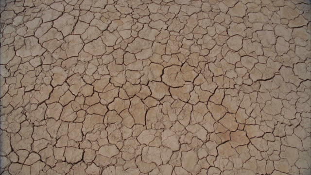 cu cracks on arid desert ground / mojave, california, usa - arid climate stock videos & royalty-free footage