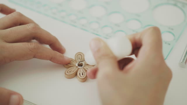 craft person working with paper craft product - drawing artistic product stock videos and b-roll footage