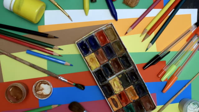 craft supplies over colorful paper - pen stock videos & royalty-free footage