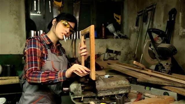 Craft woman repair old window frame
