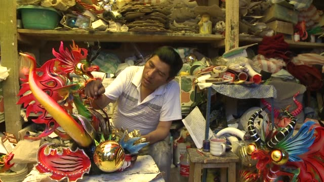 crafting elaborately painted masks and costumes with intricate embroidery the artisans in oruro prepare for the citys famous carnival celebration... - pre columbian stock videos and b-roll footage