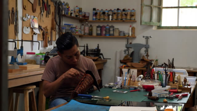 ms craftsman hand making leather purse in workshop - leather stock videos & royalty-free footage