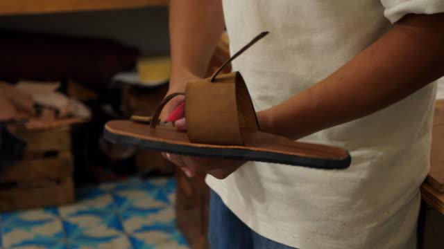 ms craftsman hand making leather sandal in workshop - sandal stock videos & royalty-free footage