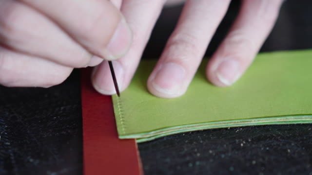 craftsman handcrafting leather wallet - home made stock videos & royalty-free footage