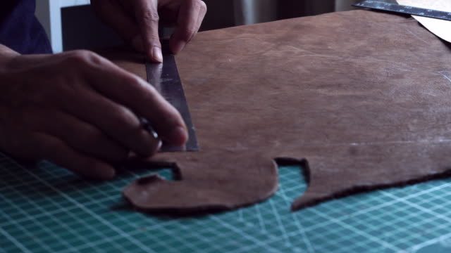 craftsman making leather bag by hand - leather stock videos and b-roll footage