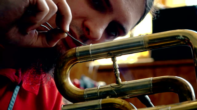 craftsman making trumpet - craft stock videos & royalty-free footage