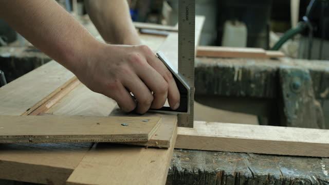 cu craftsman preparing wood in workshop - yard measurement stock videos and b-roll footage