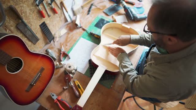 craftsman repairing guitar at the workshop - carving craft product stock videos & royalty-free footage