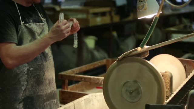 a craftsman uses a cutting wheel to engrave a design on a glass lamp shade in the cutting room at the novosad son glassworks in harrachov czech... - lamp shade stock videos & royalty-free footage