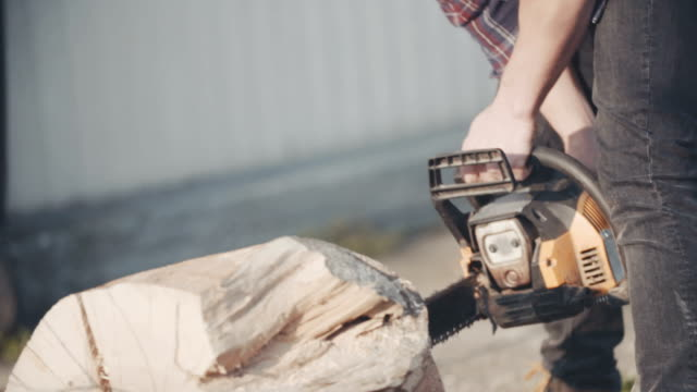 Craftsman using chainsaw.