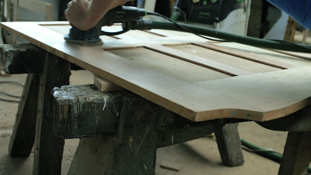cu craftsman using power tool to sand wood in workshop - polishing stock videos & royalty-free footage