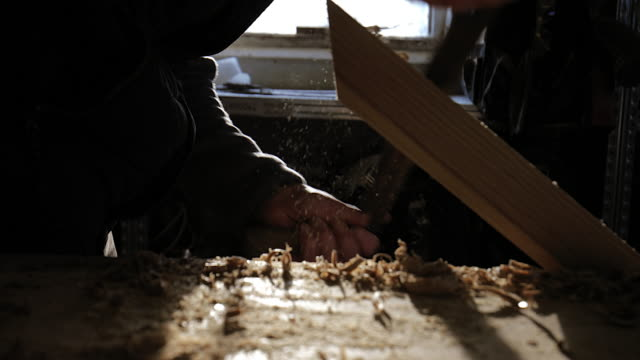 Cu Craftsman Using Traditional Woodworking Hand Tools Backlit In